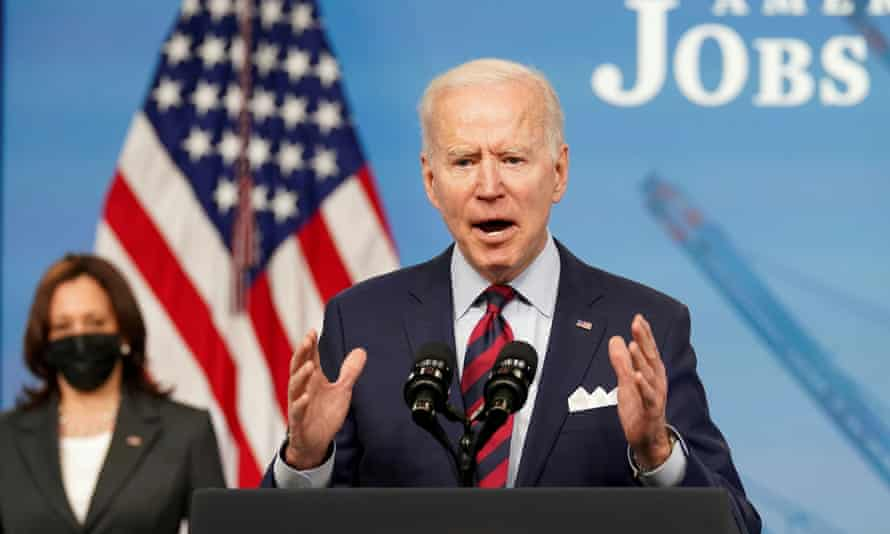 Joe Biden speaks at the White House as Kamala Harris looks on