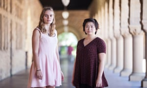 Amanda Lorei, left, and Tina Ju help organize campus demonstrations stand at the Stanford University.