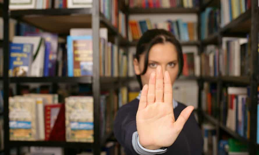 Woman giving the facepalm in a library