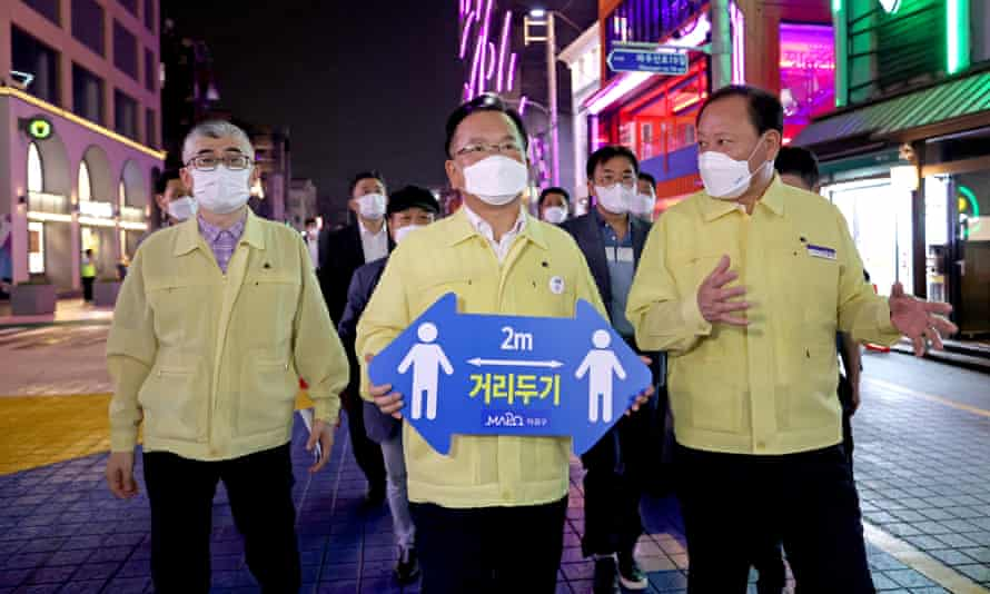 South Korean PM Kim Boo-kyum takes part in a social distancing campaign against the coronavirus in western Seoul
