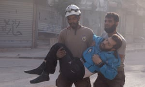 Rescuers help a wounded man in the Saladin neighbourhood of eastern Aleppo.