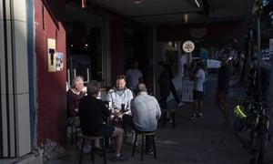 People gather outside Gusto Cafe at Bondi beach.