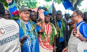 Bougainville regional president John Momis waves as he arrives at a polling station in Buka on Saturday.