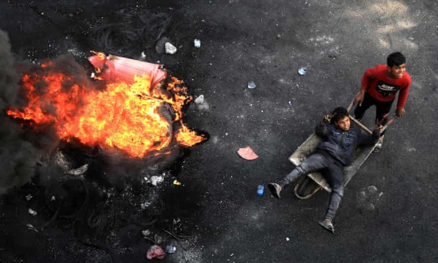 Iraqi demonstrators burn tyres in the city of Karbala during anti-government protests.