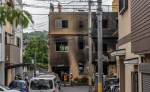 Emergency services personnel work at the Kyoto Animation studio building after an arson attack.