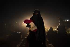 A woman and her baby, who were evacuated from the last territory held by Isis militants