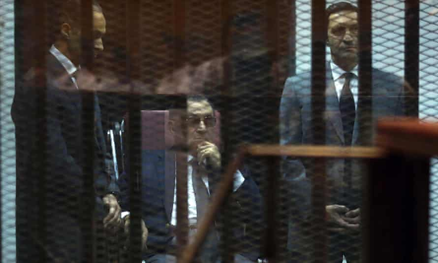 Hosni Mubarak sits between his sons Gamal (left) and Alaa, in court in Cairo