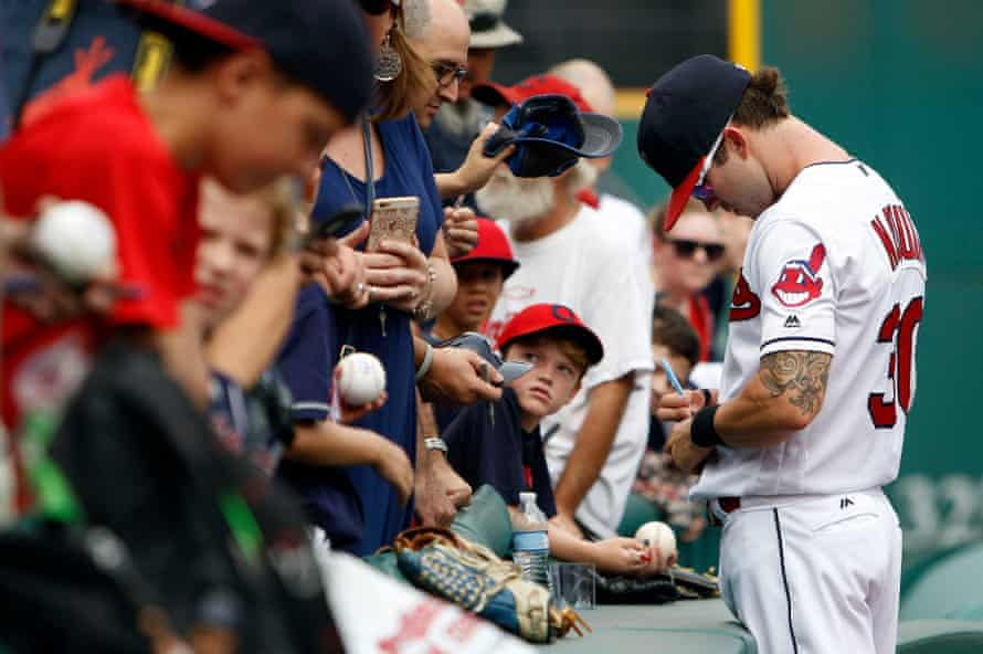 Tyler Naquin signs autographs for the fans at Progressive Field. Cleveland are third last in attendance, ahead of only Oakland and Tampa Bay.