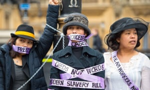 Domestic workers dressed as suffragettes demand the right to be able to change employers once in the UK at a protest in London in 2015