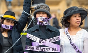 Domestic workers dressed as suffragettes protest outside the Houses of Parliament in London last March. The women wanted an amendment to the Modern Slavery Bill allowing domestic workers to change employers once in the UK