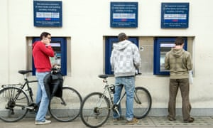 Students using ATMs in Cambridge.