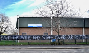 A banner supporting NHS staff outside the blood donor centre at Manchester Royal Infirmary.