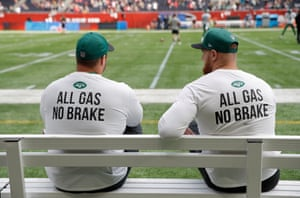 A couple of New York Jets players watch practice before kick-off.