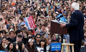 Students put up their hands when Bernie Sanders asks them how many have student debt.