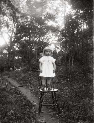"""""""Ljung's daughter standing by herself on the chair."""" Place: Torstunaby, Torstuna Parish Year: 1920"""