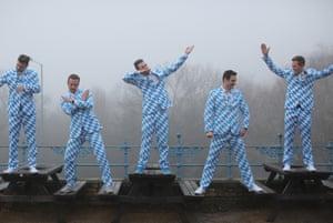Bavarian darts fans strike a pose