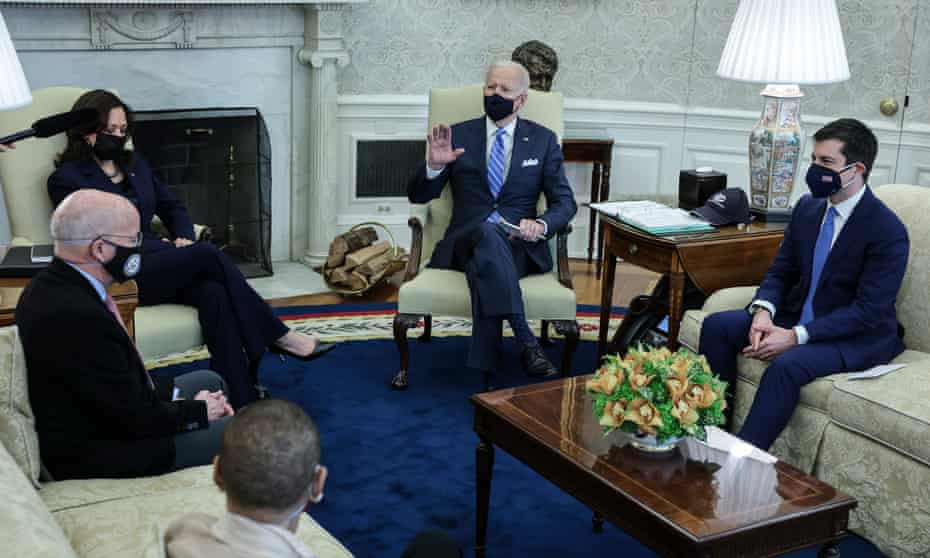 Biden with Buttigieg and other members of the bipartisan group at the White House on Thursday.
