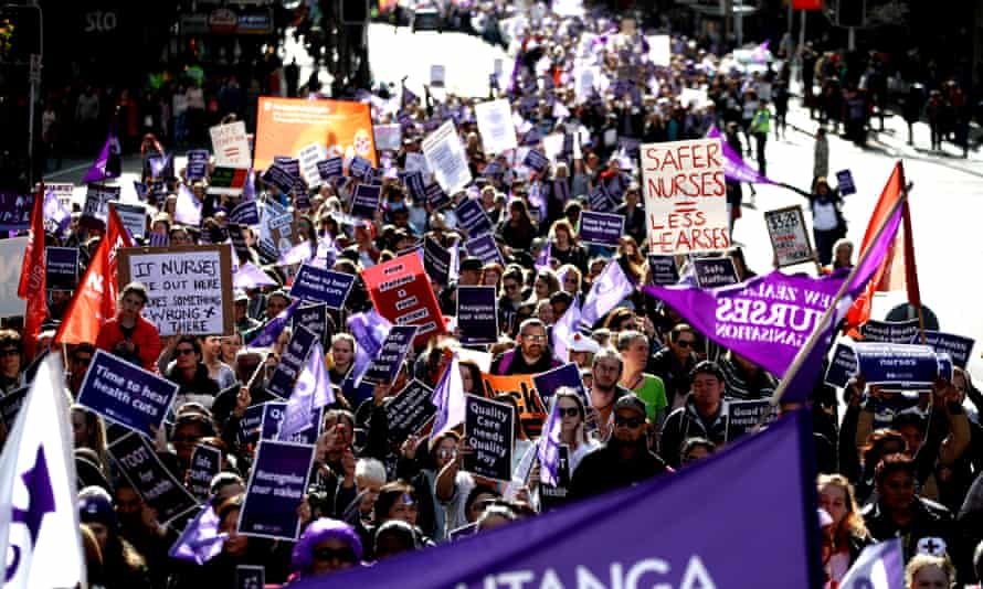 Nurses and Workers Union members march up Queen Street on 12 July in Auckland