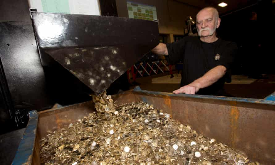 John Jones handles unminted £1 coins which will become some of the final round pound coins to be produced.