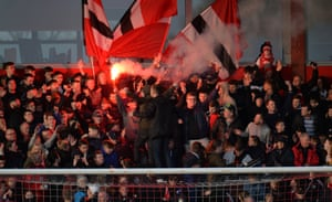 The Fleetwood Town fans set off a flare in the stands.