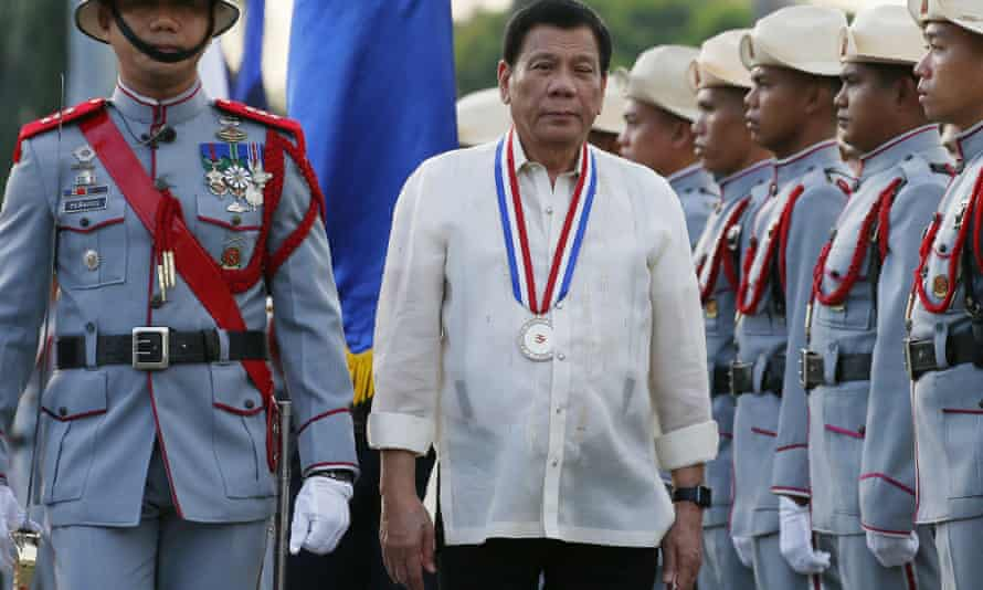 Philippine President Rodrigo Duterte reviews the troops as he leads the flag-raising ceremony to commemorate the 120th death anniversary of the country's national hero Jose P. Rizal.