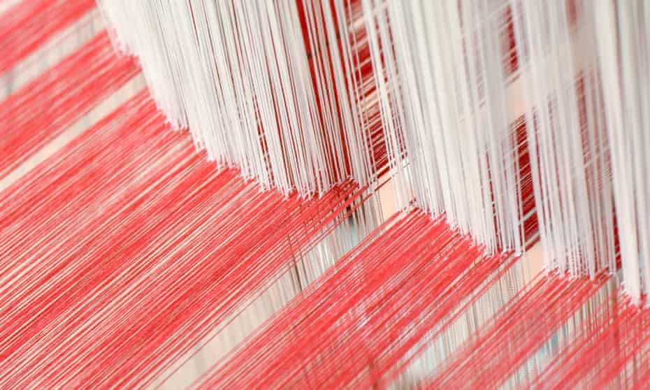 many threads of cotton on a loom
