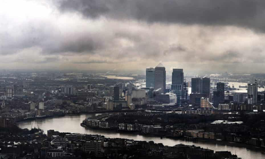 Dark clouds above London's financial district at Canary Wharf, London