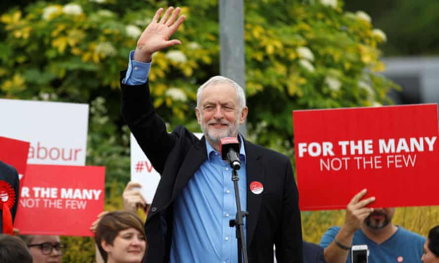 Jeremy Corbyn waves to supporters