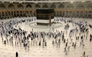 Muslim pilgrims walk around the Kaaba in Mecca, Islam's holiest site, before the beginning of the Hajj pilgrimage.