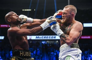 Floyd Mayweather Jr v Conor McGregorNevada , United States - 26 August 2017; Conor McGregor, right, and Floyd Mayweather Jr during their super welterweight boxing match at T-Mobile Arena in Las Vegas, USA. (Photo By Stephen McCarthy/Sportsfile via Getty Images)