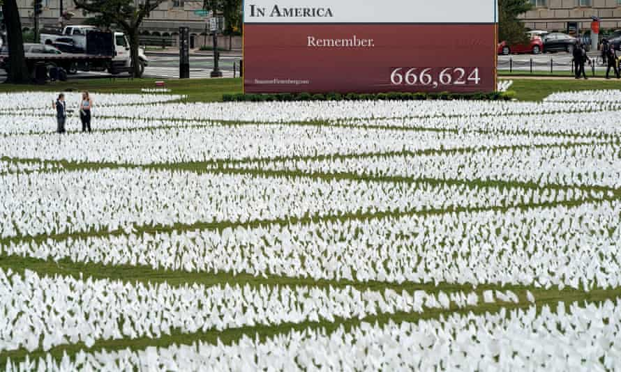 An art installation of more than 650,000 white flags representing Americans who have died of coronavirus are placed over 20 acres of the National Mall in Washington DC.