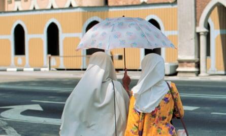 Women walk in Malaysia
