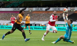 Adama Traore of Wolverhampton Wanderers lifts the ball over Arsenal keeper Emiliano Martinez and also over the bar.