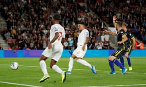 Sancho scores England's fifth after good work from Sterling.