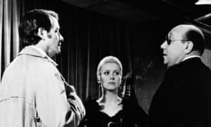 Melville (right), with Richard Crenna and Catherine Deneuve, on the set of Le Flic (1972).