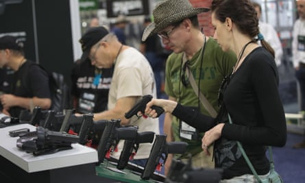 National Rifle Association members look over pistols in the Remington display at the 146th NRA annual exhibit on 29 April 2017 in Atlanta, Georgia.