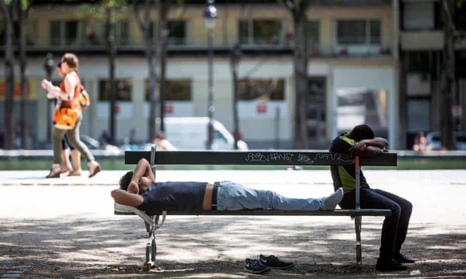 Two young men take to the shade in Paris, which is on high alert.