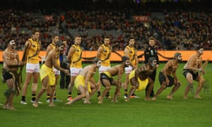 An Indigenous war dance ceremony takes place before the action gets under way at the MCG.