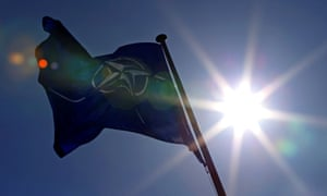 A Nato flag flies at the Alliance's headquarters in Brussels.