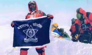 Dinesh Rathod with and Indian flag on Mount Everest. It is claimed the photo is faked
