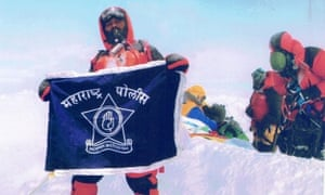 'Fake' mountaineer Dinesh Rathod with his flag. It has been claimed that this image of him and his wfie at the summit of Mount Everest was faked.