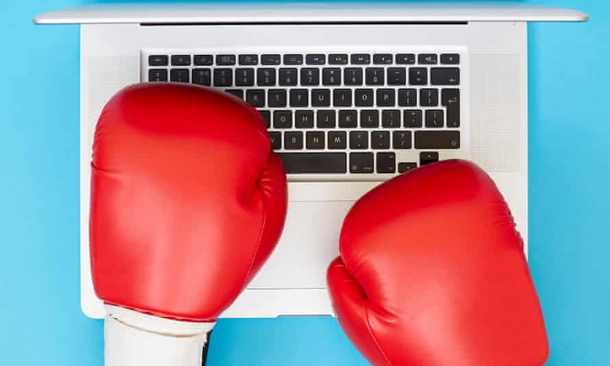 Pair of boxing gloves over a laptop