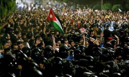 Protesters demonstrate outside the prime minister's office in Amman