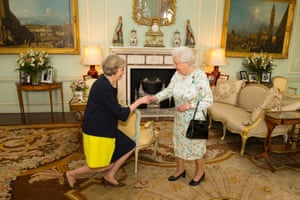 Queen Elizabeth II welcoming Theresa May in an audience at Buckingham Palace in 2016