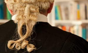 A male Barrister wearing a wig.