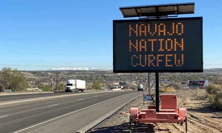 A road sign outside Bloomfield, New Mexico, warns Navajos to stay home during their nation's 8pm to 5am curfew to slow the spread of the coronavirus.