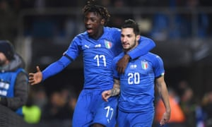 Matteo Politano celebrates his late winner against USA with his Italy teammate Moise Kean.