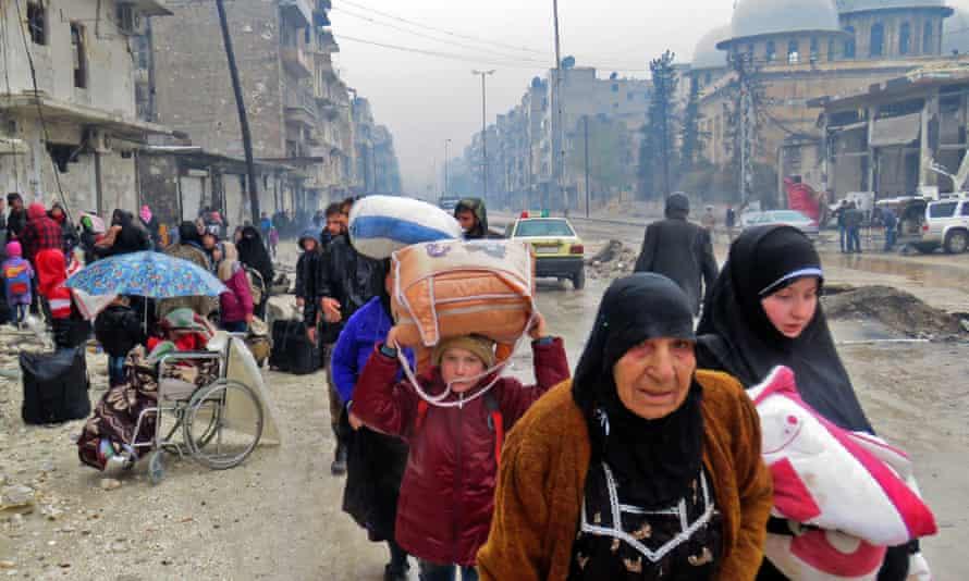 Syrian residents fleeing Aleppo's Bustan al-Qasr neighbourhood arrive in the city's Fardos district.