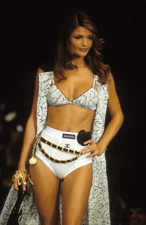 Helena Christensen walks the catwalk in a Chanel bikini for the Ready-to-Wear Spring/Summer 92/93 show