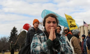A woman prays during a protest in Bismarck against plans to pass the Dakota Access pipeline under Lake Oahe.